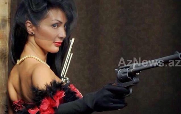 Silahla fotosu yayılan direktora yeni vəzifə verildi