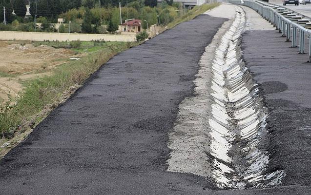 Yağışa görə dağılan yollar bərpa olundu